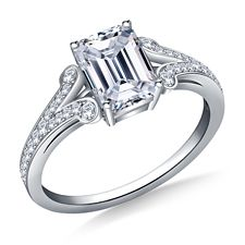 This attractive #engagementring features a #splitshank with #scrollededges lending it plenty of #vintage appeal. #Prongs secure the #centerstone of your choice while #glittering #pave #diamonds along the bands provide plenty of #sparkle. Expertly crafted, the #moderndesign pays homage to the #elegance of the past.