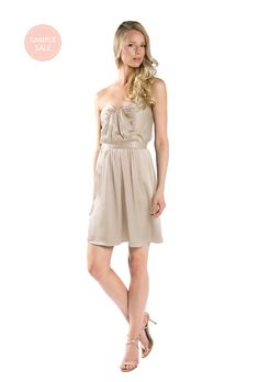 A short, strapless charmeuse bridesmaid dress with a sweetheart neckline in four colors. Affordable designer bridesmaid dresses to buy or rent at Vow To Be Chic.