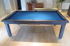 Our Modern Pool Table shown in a 7' English Oak colour 13 with a Slate Blue cloth: www.Luxury-Pool-Tables.co.uk
