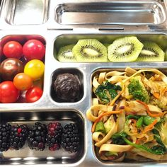 This is my daughter's @planetbox lunch for Wednesday, taken from her view as she opens up the tray. She has homemade veggie lo mein, blackberries, kiwi, heirloom grape tomatoes, and a dark chocolate covered marshmallow from #traderjoes. #lunch #bento #bentobox #organic #organicfood #healthy #healthyfood #healthykids #healthylife #Healthyfamily #instafood #instagood #eatyourveggies #eattherainbow #cleaneats #cleaneating #healthychoices #picoftheday #foodpic #foodie #eeeeeats #feedfeed #yum…