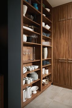 Built-in pantry storage, as shown in the contemporary Urban Revival kitchen by #WoodMode.