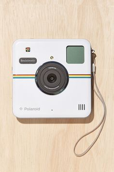 White Polaroid Socialmatic Camera.