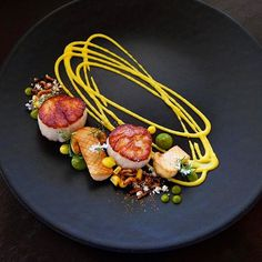 Scallops with matsutake, corn, salsa verde, smoked cotija, chili garlic oil, puffed wild rice & shishito powder. Dish uploaded by @karloevaristo #gastroart