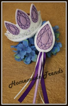 Princess Crown and Wand Play Set ~gorgeous embroidered detail ~highest point of crown measures 4 ~satin hard headband slides out of crown for easy, flat storage ~wand measures 13 end to end ~ matching ribbon streamers and ribbon wrapped wooden dowel for wand handle ~fabulous gift for the princess in your life! ~All crown and wand sets are made to order.   NOTE: As of 12/17/15 Crown and Wand sets will now only ship Priority Mail. This does not ensure faster creation time, but gives you…