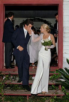 John F. Kennedy, Jr., and Carolyn Bessette Kennedy (in a pearl-colored silk crepe gown by Narciso Rodriguez) on Cumberland Island, off the coast of Georgia, in 1996.    Photo: Denis Reggie