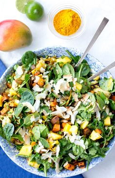 Spinach, mango and curried sweet potato salad is packed with Indian flavor and full of texture. Gluten free, dairy free, paleo and vegan.