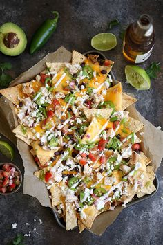These aren't any ordinary nachos – they have three different types of cheese. The nachos are first topped with queso, then melted cheddar cheese and crumbled queso fresco. Entree Recipes, Mexican Food Recipes, Cooking Recipes, Healthy Recipes, Skillet Recipes, Cooking Tools, Dip Recipes, Recipies, Loaded Chicken Nachos Recipe