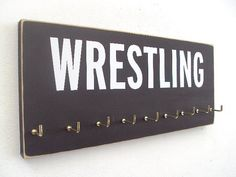 Wrestling in 10 colors medals holder by runningonthewall on Etsy, $28.00