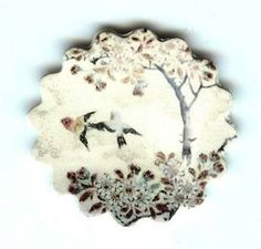 Flying Birds Brooch by design mosaic. Two birds fly by a tree. Made from polymer clay. The image is from antique Japanese satsuma pottery. #handmade #jewelry