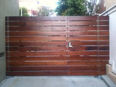 Horizontal garden wooden board fence with door
