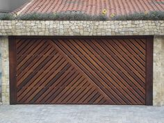 http://www.core77.com/posts/41006/Unusual-Door-Designs-from-Brazil-Part-2-Garage-Doors-with-Style