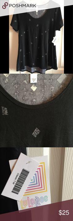NWT LuLaRoe classic t-shirt size medium NWT LuLaRoe classic T-shirt. Size medium. Black with gray designs. Feels like the leggings material...so soft! LuLaRoe Tops Tees - Short Sleeve