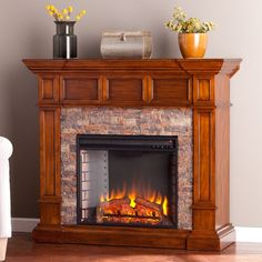 Explore the old west with this handsomely carved buckeye oak electric fireplace. Smartly stacked simulated stone is framed by dynamic, dimensional woodwork. Designed to stand against a wall or buttress a corner, warm up any room with this traditional style piece. LED bulbs light the fire. An automatic shutoff and glass that remains cool to the touch ensure the fireplace warms safely. Turn off the heat to enjoy the fireplace ambiance year round!