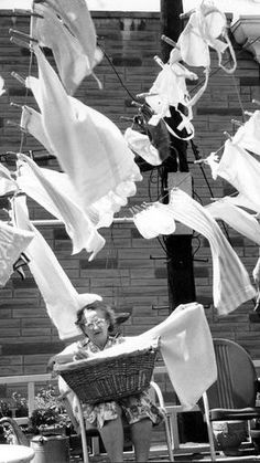 1968: Sun photographer Joseph DiPaola got this picturesque photo of Mrs. Charles J. Kafka sitting with her wash as she had it out to dry in the Patterson Park neighborhood.