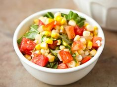 Basil-Corn Salad... Blogger Angie McGowan of Eclectic Recipes shares a fresh corn salad recipe perfect for a potluck.