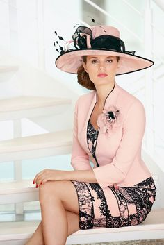 "A stylish print crepe strip effect dress with layers which will flatter all figures. It is matched with a pretty crepe jacket with _ length sleeves and has contrasting piping and a corsage. A very classy outfit that will suit any ""/Groom."
