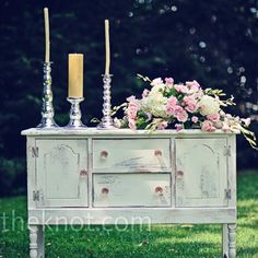 Idea: old cabinet used outside with flower/candles and guest book, and maybe an engagement photo when guests enter