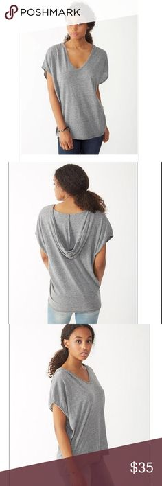 SHORT SLEEVE DOLMAN PONCHO A soft, lightweight hooded top with dolman style short sleeves for a relaxed look. Perfect to layer over thin tanks or workout wear. Alternative Apparel Sweaters Shrugs & Ponchos