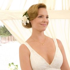"Brides.com: . 27 Dresses. Always a bridesmaid and never a bride — until, 27 ""I dos"" later, Jane (Katherine Heigl) finally walked down the aisle as the bride in a simple, sleeveless dress for her beachfront wedding to Kevin (James Marsden)."