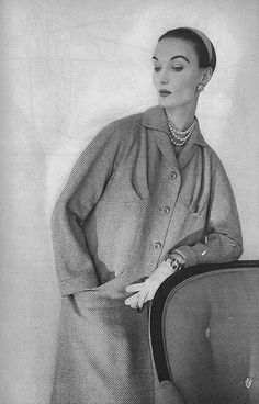 April Vogue 1953 Eve is wearing Mainbocher's new full length bolero coat, with curved pleats over the bust and non-existent shoulders.