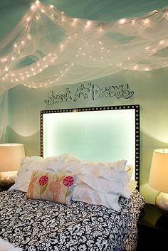 An innovative backdrop of LED lighting provides an enchanting design element to the headboard of this teenage girls' new bedroom. - Interior design by ComplementsHome.com in Bend, Oregon