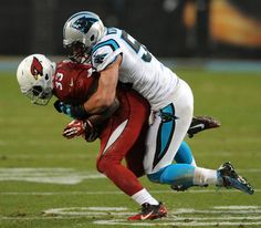 Carolina Panthers linebacker Luke Kuechly (59) makes the tackle on Arizona Cardinals running back Kerwynn Williams (33) during first quarter action at Bank of America Stadium on Saturday, January 3, 2015. The Panthers defeated the Cardinals 27-16 in NFL Wild Card action.