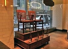 shoe shine stand.....one simular to this in my Dad's Barber Shop.