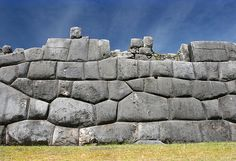 Sacsayhuaman Cusco Peru - There are no other walls like these. They are different from Stonehenge, different from the Pyramids of the Egyptians and the Maya, different from any of the other ancient monolithic stone-works. The stones fit so perfectly that no blade of grass or steel can slide between them. There is no mortar.   They often join in complex and irregular surfaces that would appear to be a nightmare for any stonemason.