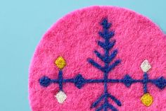 Needle felt a colorful coaster with this tutorial.