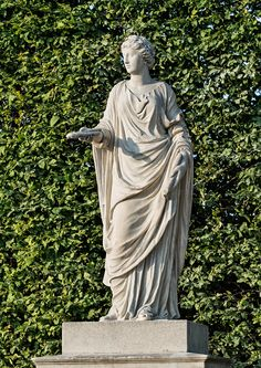 CALLIOPE, THE 'BEAUTIFUL-VOICED', MUSE OF EPIC POETRY (No. 2) Crowned with a laurel wreath, the figure carries a scroll in her left hand and two flutes in her right hand, attributes that identify her as the Muse of epic poetry. Muse, Laurel Wreath, Beautiful Voice, Vienna, Austria, Sculpture, Artist, Flutes, Sculptures