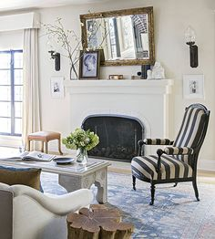 Varying Heights--love the navy striped chair!