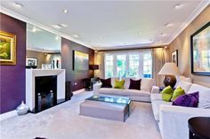purple accent wall in the living room << This is Eamonn Holmes' house in Weybridge, Surrey. Currently for sale with Curchods Estate Agents in Weybridge.