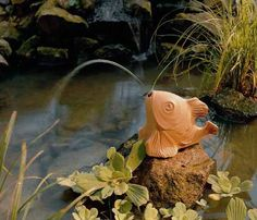 fish like water fountain is one of modern yard decorations to feng shui a home