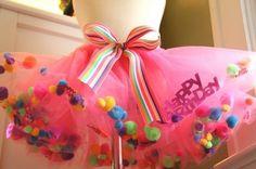 a tutu filled w/ pompoms and birthday confetti