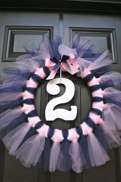 Tuts & Ties party. Tutu wreath for the front door. Super easy to make and it held up great even through a rainstorm.