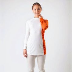 The Bon Voyage Top is made entirely from Australian merino wool with a moc-turtleneck. Merino has a natural elasticity which makes this top perfect for travel, work or casual occasions. Shop the Australian made range at thedresscollective.com