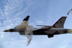 """""""Capt. Chris Stricklin ejects from the USAF Thunderbirds number six aircraft less than a second before it impacted the ground at an air show at Mountain Home Air Force Base, Idaho, Sept. 14 2003. Stricklin, who was not injured, ejected after both guiding the jet away from the crowd of more than 60,000 people."""" Too bad about the aircraft but Well Done on getting it out of the way! and cheers to Staff Sgt. Bennie J. Davis III who took this fantastic photo!"""