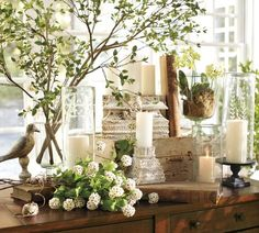 <3 everything about this! Faux Green Spring Branches from Pottery Barn. Candle holders are simply gorgeous!