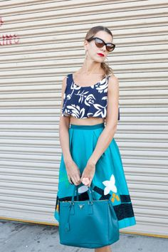 Natalie Joos in a vintage top, OSCAR DE LA RENTA skirt, turquoise PRADA bag, and TOM FORD sunglasses.