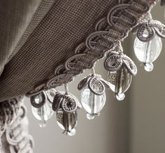 "Turn a roman shade, drape, lampshade or pillow into ""house jewelry"""