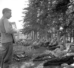 A Finnish soldier entertains comrades on Juhannuspäivä (St. John's Day, or Midsummer) with a selection of popular Finnish songs on the accordion during the Finnish-Soviet Continuation War. Valaam (Finnish: Valamo), Karelia, Finland (now in Republic...