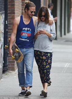 Happy days: Alexa and her friend went for a walk through the East Village, where the Brit has been living since her split from Acrtic Monkeys frontman Alex Turner in 2011