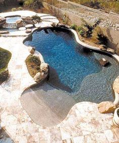 Desert oasis The sleek large flagstones surrounding this pool emphasize and accent this concrete free-form design to help it fit in with its desert surroundings. The flagstone is continued in the raised spa and deck to create a natural flow from one area to the other. By Shasta Pools of Phoenix, Ariz. See link below for special section covering everything you need to know about pools.
