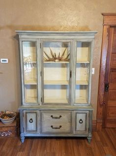 """Raychel Thomas says """"Dixie Belle Dried sage for a base coat and Dixie Belle Drop cloth inside...dry brushed and layered with many random colors...I love how my hutch turned out and the reason it turned out so great...the amazing paint I used to refinish!!! I♡DB ☆☆☆☆☆"""" #DixieBellePaint super easy, super affordable!"""