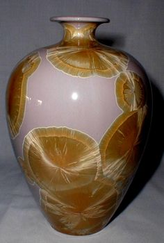 crystalline glaze...we have a family friend who does this kind of work. It looks even more amazing in real life!!