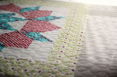Quilted Swoon by frommartawithlove, via Flickr, featuring Modern Whimsy fabric by Laurie Wisbrun