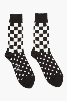 COMME DES GARÇONS HOMME PLUS //  Black Jersey Checker & Dot Patterned Socks  31347M137001  Stretch cotton-blend socks in black and off-white. Checkered and polka-dot pattern throughout. Logo at sole in white. Ribbed ankle cuff. Tone on tone stitching. 65% cotton, 25% acrylic, 10% nylon. Hand wash. Made in Japan.  $45 CAD