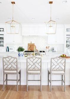 Kitchen Remodeling White kitchen with open brass pendants over the island and gray lattice backed counter stools - Studio McGee - Are you starting to plan a kitchen renovation? I'm sharing ideas and inspiration for our kitchen remodel must-haves! All White Kitchen, White Kitchen Cabinets, New Kitchen, Kitchen Dining, Kitchen Cabinetry, Kitchen Backsplash, Country Kitchen, White Kitchen Stools, White Counter Stools