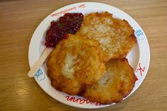 The kartoffelpuffers at the Nuremberg Christmas market which are kind of like hash browns are typically served with applesauce or cranberry sauce.  Don't make the mistake of thinking these are vegetarian as they are cooked in a fairly significant amount of lard (pig fat).
