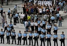 About 50 students shout slogans inside the government headquarters before they were arrested by police in Hong Kong, Saturday, Sept. 27, 2014. Riot police in Hong Kong on Saturday arrested scores of students who stormed the government headquarters compound during a night of scuffles to protest China's refusal to allow genuine democratic reforms in the semiautonomous region. Photo: Vincent Yu, AP / AP